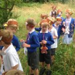 KS1 children under the parachute (bed covers) at the end of the bear hunt!