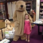 A bear hunter hugs the Walker bear at Waterstones Birmingham