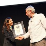 Fortuna from GUINNESS WORLD RECORDS™ hands over the certificate to Michael Rosen