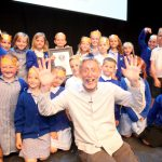 Michael Rosen celebrates with a school ontsage